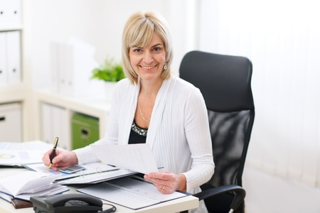 Happy business woman working at office Stock Photo - 12637771