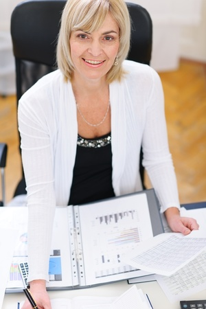 Senior business woman working at office Stock Photo - 12637803