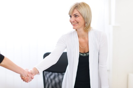Happy senior business woman greeting visitor at office Stock Photo - 12637774