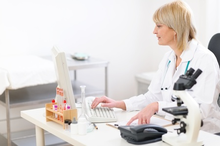 centrality: Senior doctor woman working on computer