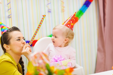 Mother and baby having fun at birthday party Stock Photo - 12930591