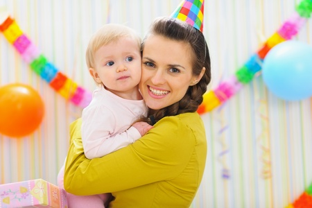 Portrait of happy mother and baby at birthday party Stock Photo - 12930724