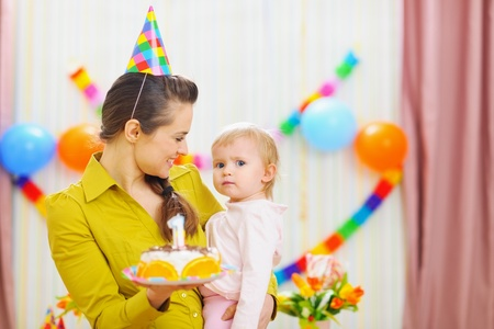 Portrait of baby and mother with birthday party cake Stock Photo - 12930728