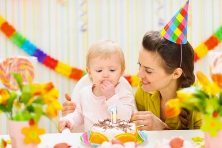 Portrait of happy mom and baby eating birthday cake Stock Photo - 12930725