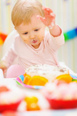 eat smeared baby: Eat smeared baby having fun with birthday cake