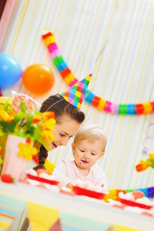Mother and baby having fun at birthday party photo