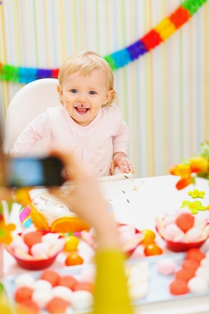 Mother making photos of baby on birthday party Stock Photo - 12930579
