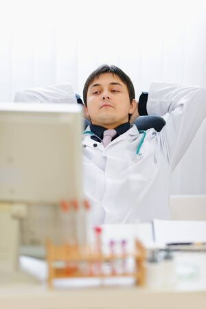 sagacious: Portrait of thoughtful medical doctor at office Stock Photo