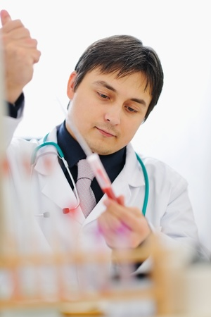 centrality: Male researcher working with blood sample Stock Photo
