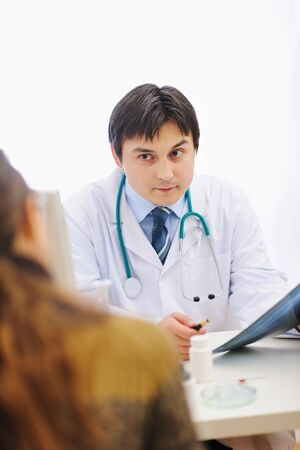 Medical doctor attentively listening patients photo