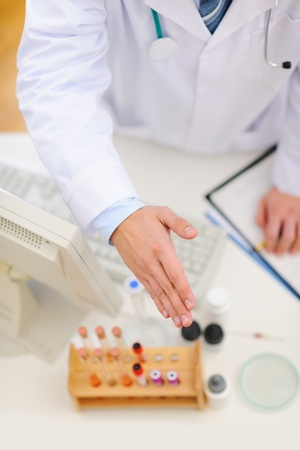 Medical doctor stretching hand for handshake. Top view photo