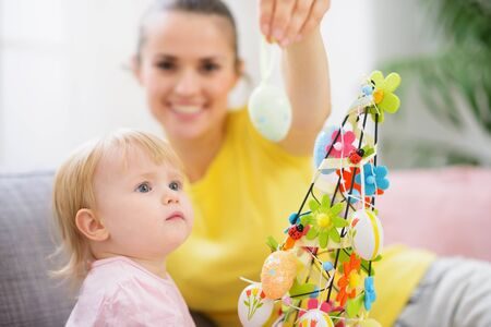Mother showing baby Easter egg Stock Photo - 12930633
