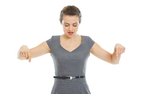 wonder woman: Surprised business woman pointing down Stock Photo