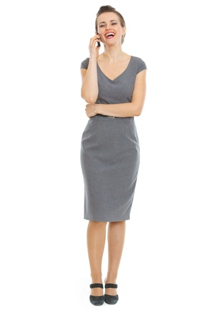 working dress: Elegant woman in dress speaking phone