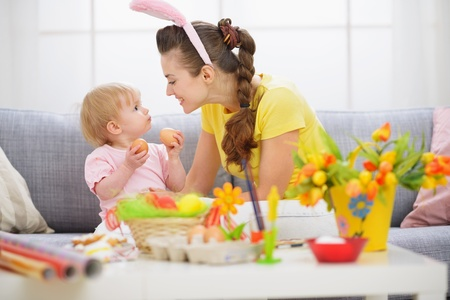 easter basket: Mother and baby playing with Easter eggs Stock Photo