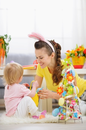 Mother and baby playing with Easter decoration Stock Photo - 13008748