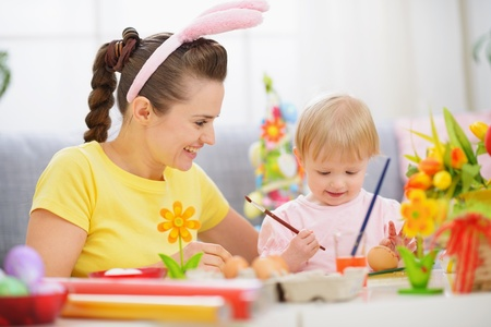 Mother and baby painting on Easter eggs Stock Photo - 13008756