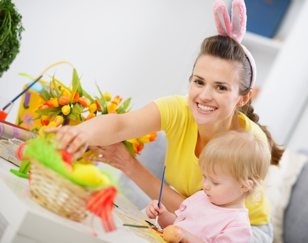 Mother and baby making easter decoration Stock Photo - 13008759