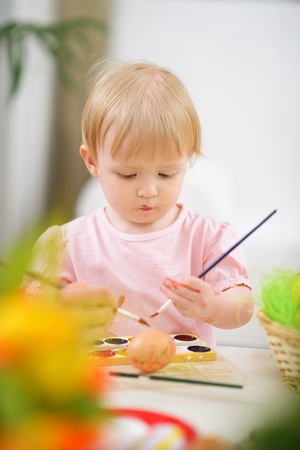 smeared baby: Color smeared baby painting Easter egg Stock Photo