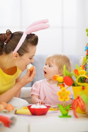 Mother and baby eating Easter egg Stock Photo - 13008745