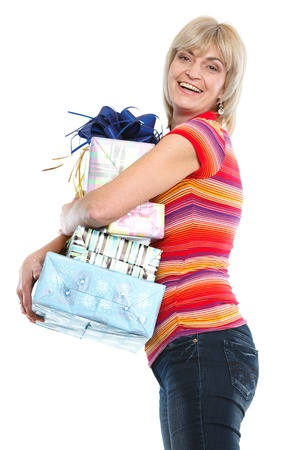 Smiling middle age woman with stack of present boxes