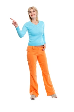 Full length portrait of middle age woman pointing in corner photo