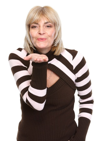 Middle age woman blowing air kiss photo