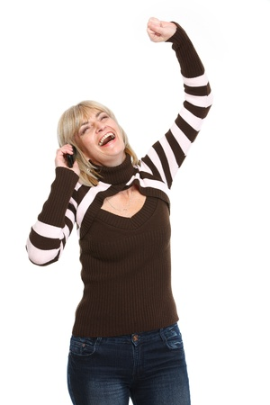 Happy middle age woman talking by phone and rejoicing success photo