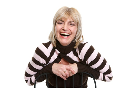 Portrait of smiling middle age woman sitting on chair Stock Photo - 13008769