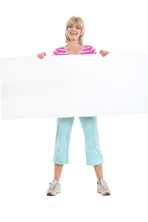 Full length portrait of smiling middle age woman holding blank billboard photo