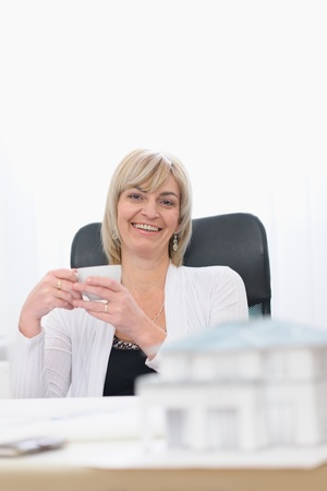 Happy architect woman having coffee break photo