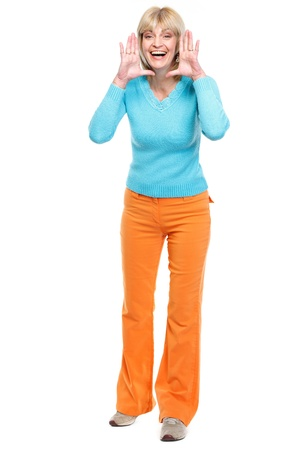 shaped hands: Happy middle age woman shouting through megaphone shaped hands
