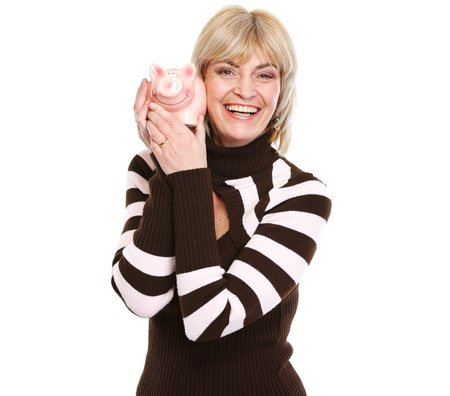 Smiling middle age woman holding piggy bank Stock Photo - 13087683