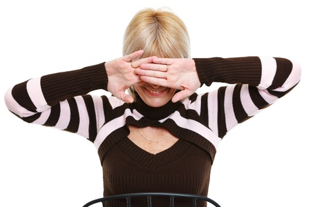eyes closing: Senior woman closing eyes by hand Stock Photo