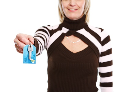 Closeup on key in hand of realtor woman Stock Photo - 13087663
