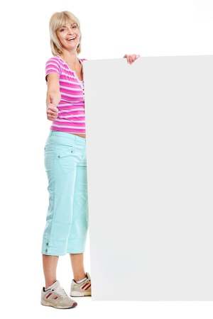 Happy senior woman holding blank billboard and showing thumbs up photo
