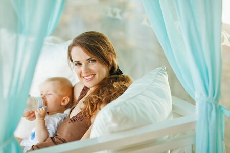 Happy woman feeding baby Stock Photo - 13115975