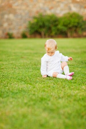 Baby sitting on grass Stock Photo - 13116085