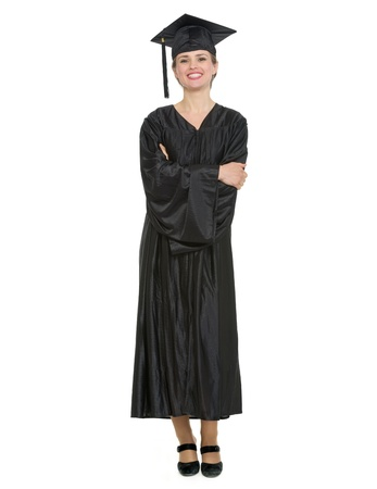 Full length portrait of woman in graduation cap and gown.  photo