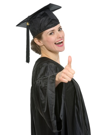 Smiling graduation student woman showing thumbs up.  photo