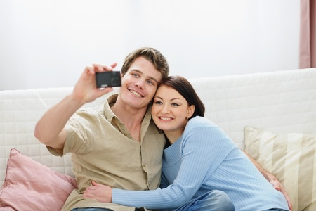 Smiling young couple making self photo photo