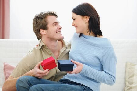 Romantic couple exchanging presents photo