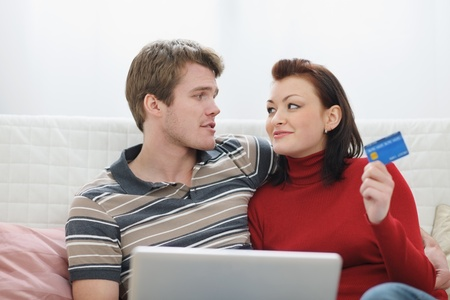 Young couple making online purchases photo