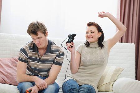 rejoicing: Girl rejoicing that beat boyfriend in console