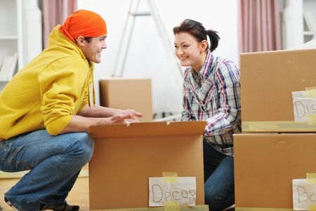 moving box: Moving young couple searching something in box