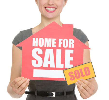 Closeup on home for sale sold sign holding by happy female. HQ photo. Not oversharpened. Not oversaturated Stock Photo - 13407589