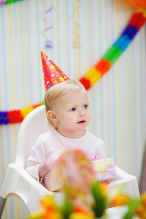 Celebrating birthday baby looking in corner Stock Photo - 13407626