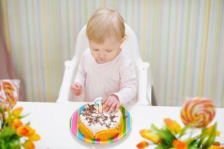 Baby eating birthday cake Stock Photo - 13407708