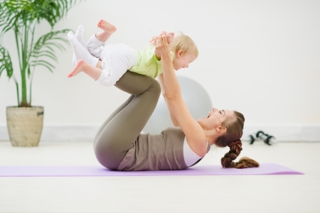 mom baby: Healthy mother and baby making gymnastics