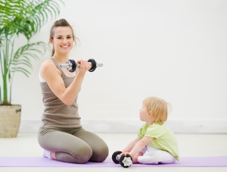 Mother and baby spending time doing fitness photo